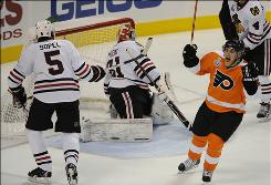 Matt Carle, right, scored a goal to help the Flyers draw even with the Blackhawks in the Stanley Cup Final after winning Game 4.