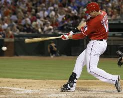 The Rangers' Justin Smoak's career-best three-hit game included a home run as Texas came back to beat the Tampa Bay Rays.