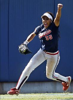Arizona's Brittany Lastrapes celebrates after making the final out that knocked out defending Women's College World Series champion Washington out of the tournament. The Wildcats won 4-3.