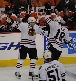 Patrick Kane, celebrating with teammate Jonathan Toews after scoring a third-period goal during Game 3 of the Stanley Cup Final, thinks playing on a different line could help the Blackhawks in Game 5 against the Flyers.