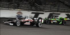 Ryan Briscoe (6) passes Danica Patrick during the Firestone 550 on his way to victory. Patrick finished a season-high second.