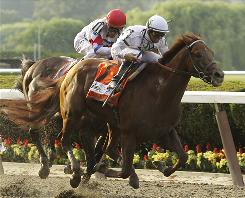 Jockey Mike Smith rides Drosselmeyer to win the 142nd running of the Belmont Stakes ahead of Ramon Dominguez atop First Dude. Drosselmeyer, along with Super Saver who won at Churchill Downs, gave WinStar Farm's racing manager, Elliott Walden, victories at two of the three legs of the Triple Crown this year.
