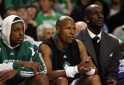 Paul Pierce, left, Ray Allen, center, and Kevin Garnett watch from the bench during a 2009 playoff game. The trio, all of whom are at least 32 years old, are not phased by questions concerning their age.