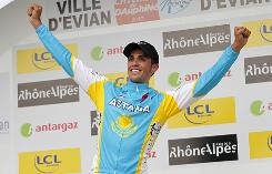 Alberto Contador celebrates after winning the Dauphine Libere prologue in Evian, France.