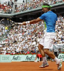 Rafael Nadal of Spain hammers a forehand Sunday during his straight-sets victory against Sweden's Robin Soderling in the French Open final. Nadal is 38-1 overall at Roland Garros with five titles.