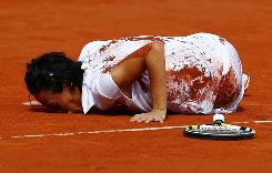 Francesca Schiavone of Italy kisses the court to celebrate wnining the French Open singles title Saturday, a 6-4, 7-6 (7-2) victory against Samantha Stosur of Australia. Schiavone is the first Italiam woman in the Open era to win a Grand Slam singles title.