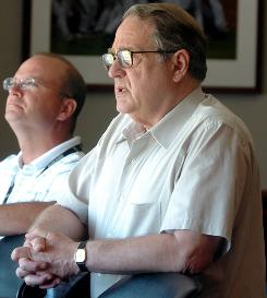 Jerry Reinsdorf, right, owner of the Chicago White Sox and Chicago Bulls, watches a White Sox game.  Reinsdorf headed a group that was in the running to purchase the Coyotes before withdrawing on Monday night.