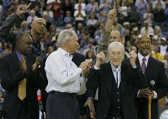From left, former UCLA assistant coach Jerry Norman, left in light shirt, joins players Lucius Allen, Kareem Abdul-Jabbar, Ken Heitz and Mike Warren in saluting John Wooden in 2007.
