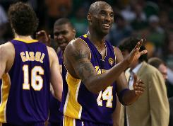 Kobe Bryant is all smiles as his Lakers teammates head to the bench in the late stages of Game 3 against the Celtics. Bryant finished with a game-high 29 points.