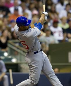 Cubs first baseman Derrek Lee follows through on his fifth-inning home run. Marlon Byrd followed with another homer to help Chicago beat Milwaukee.