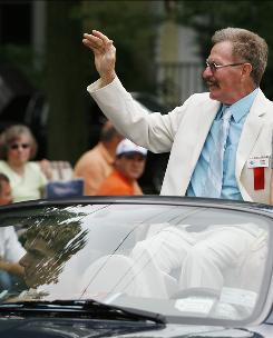 2010 International Boxing Hall of Fame inductee Danny Lopez waves to fans during the Parade of Champions on Sunday in Canastota, N.Y.