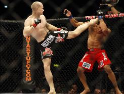 Denmark's Martin Kampmann lands a kick on Brazil's Alexandre Barros during a Welterweight bout at UFC 93 on Jan. 17, 2009. Kampmann will face Brazil's Paulo Thiago at UFC 115 on Saturday night.