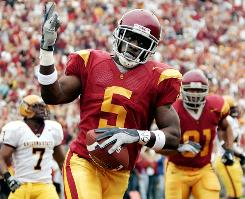 Southern California is ineligible to play in the postseason for the next two football seasons after the NCAA ruled Reggie Bush received extra benefits while playing for the Trojans.