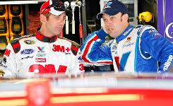 Ford driver Greg Biffle, left, talks with Roush Fenway Racing teammate Matt Kenseth in the Talladega Superspeedway garage earlier this season. Kenseth ranks fourth in the Sprint Cup standings, with Biffle 10th.