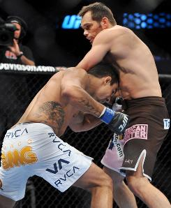 Rich Franklin, right, battling Vitor Belfort in September, replaced Tito Ortiz in a bout against Chuck Liddell for Saturday's UFC 115.