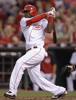 Reds' Brandon Phillips had four hits, including a two-run triple in the eighth inning against the Giants.