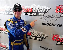 Kurt Busch, pointing to his signature, qualified first for Sunday's NASCAR Sprint Cup race at Michigan International Speedway.