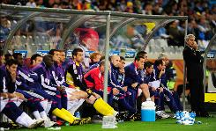 France coach Raymond Domenech and his bench look on dejectedly during their scoreless Group A match against Uruguay. Domenech chose to bench usual starter Florent Malouda and elected to bring star striker Thierry Henry off the bench for the contest.