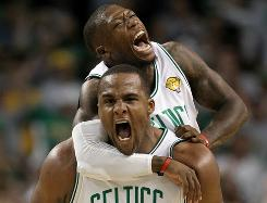 Super subs Glen Davis, bottom, and Nate Robinson of the Boston Celltics celebrate in the fourth quarter of Friday's Game 4 in the NBA Finals.