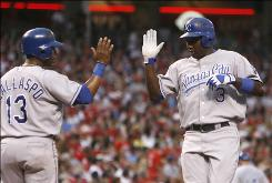 The Royals' Yuniesky Betancourt, right, is congratulated by teammate Alberto Callaspo, left, after hitting a two-run homer in the sixth inning. Betancourt would later drive in the winning run in the 11th.