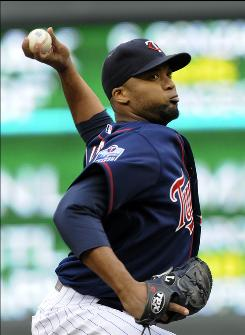 Twins starter Francisco Liriano had a season-high 12 strikeouts and improved to 6-3 as Minnesota edged Atlanta 2-1.