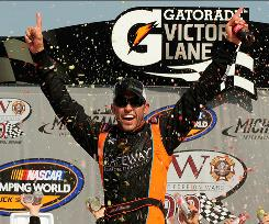 Aric Almirola celebrates after winning the VFW 200 at Michigan International Speedway, the second Trucks Series victory of his career.