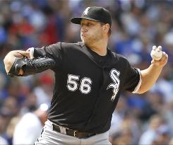 Mark Buehrle pitched scoreless ball into the seventh inning to help the White Sox beat the crosstown rival Cubs for their fourth straight win.