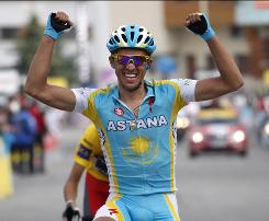 Astana's Alberto Contador, of Spain, celebrates as he crosses the finish line to win the sixth stage of the 62nd Dauphine Libere cycling race between Crolles and the Alpes d'Huez in the French Alps.