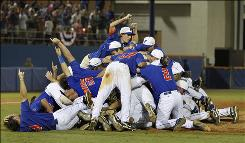 The Florida Gators celebrate their 4-3 win over Miami (Fla.) in Game 2 of their super regional matchup. With the victory, Florida clinched its sixth berth in the College World Series.