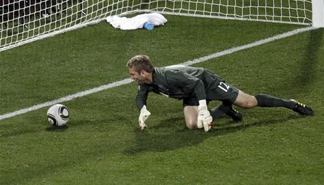 England goalie Robert Green helplessly watches the ball go into the net after his blunder on a shot by the USA's Clint Dempsey in the 40th minute.