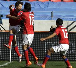 South Korea's Park Ji-sung, left, celebrates with his teammate Ki Sung-yong after scoring during their World Cup Group B soccer match against Greece in Port Elizabeth, South Africa on Saturday. South Korea went on to a 2-0 victory.