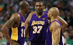 Ron Artest (37) talks with Lakers teammates Kobe Bryant, left, and Derek Fisher during the second quarter of Game 5.