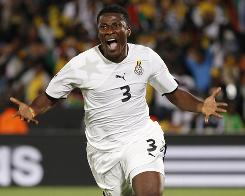 Ghana's Asamoah Gyan celebrates after scoring a goal on a penalty kick in the 84th minute of his squad's 1-0 victory over Serbia in Pretoria, South Africa.
