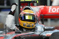 Lewis Hamilton celebrates from his car after winning the Canadian Grand Prix at the Circuit Gilles Villeneuve in Montreal.