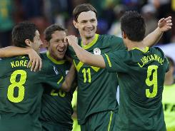 Slovenia's Robert Koren, left, celebrates with teammates after scoring the winning goal during their match against Algeria in Polokwane, South Africa.