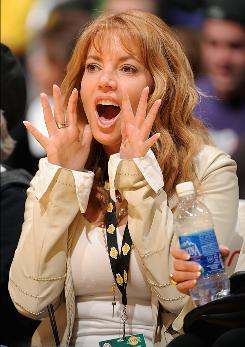 Los Angeles Lakers Executive Vice President Jeanie Buss cheers during a game last season against the Los Angeles Clippers. With her significant other, Lakers head coach Phil Jackson, going into free agency after the season, Buss is having a tough time choosing between the happiness of her father, current team owner Dr. Jerry Buss, and her beau.