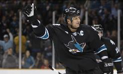 San Jose Sharks defenseman Rob Blake celebrates a goal against the Dallas Stars on March 25 in San Jose, Calif. Blake is retiring from the NHL after a 20-year career as one of the league's top defensemen. Blake will make the retirement official at a news conference on Friday.