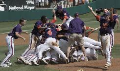Clemson players react after defeating Alabama 8-6 in the deciding game of their NCAA super regional in Clemson, S.C., on Monday. The victory earned Clemson a spot in the College World Series.
