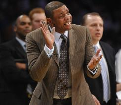 "Boston head coach Glenn ""Doc"" Rivers urges on his team in Game 2 of the NBA Finals, where he is now one win away from his second title."