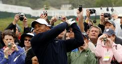 Fans get close-ups of Tiger Woods during a practice round Momday at Pebble Beach. In 2000 Woods dominated the U.S. Open on this seaside course, winning by a record 15 shots.
