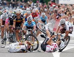 Mark Cavendish from Team HTC-Columbia, center, and German Heinrich Haussler from Cervelo Test Team, crash during Stage 4 of the Tour of Switzerland road bike race Tuesday in Wettingen, Switzerland. Cavendish suffered abrasions but no serious injuries.