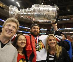 Chicago Blackhawks right wing Adam Burish, celebrating with the Stanley Cup at Wachovia Center, called Chris Pronger an idiot in a post-game interview.