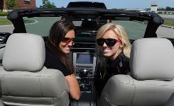 Courtney Force, right, and sister Ashley Force Hood check out a 2011 Mustang convertible at Ford World Headquarters in Dearborn, Mich.