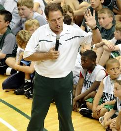 Tom Izzo talks to youth about shooting the ball during his basketball camp at Michigan State one day before announcing he would stay with the Spartans.