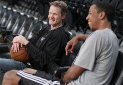 Steve Kerr, left, laughs with Suns forward Channing Frye during a break in practice last month in the Western Conference finals.