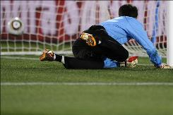 North Korea goalkeeper Ri Myong-Guk watches as the ball rolls into the goal during his squad's Group G match against Brazil. Brazil won 2-1.
