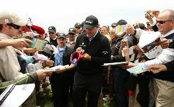 Phil Mickelson signs autographs for fans during a practice round Tuesday in advance of the 110th U.S. Open at Pebble Beach Golf Links. Mickelson, a three-time winner at Pebble Beach, is looking for his first U.S. Open title.