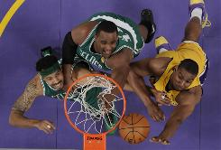 """Rasheed Wallace, left, and Glen Davis, battling Andrew Bynum, will get more playing time with Kendrick Perkins out with a knee injury. """"We're going to need him big,"""" Celtics coach Doc Rivers said of Wallace."""