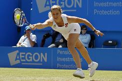 Kim Clijsters of Belgium chases down a forehand during her second-round victory Wednesday against Lucie Safarova of the Czech Republic at the Aegon International in Eastbourne, England.