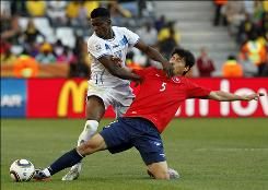 Chile's Pablo Contreras gets a face full of Honduras' Edgard Alvarez during their Group H match. Chile's 1-0 victory was its first World Cup win since 1962.